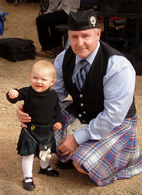 Van and his oldest granddaughter dressed in scottish kilts at the highland games